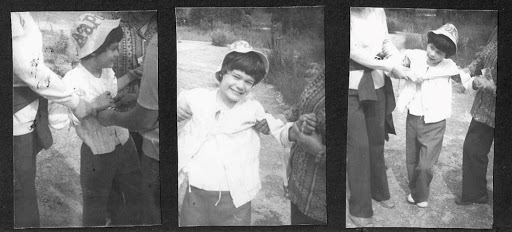 Three black and white photographs in a row. They all show a young Coquis being held by arms and hands. The faces of the people grabbing her are cut out of the frame.