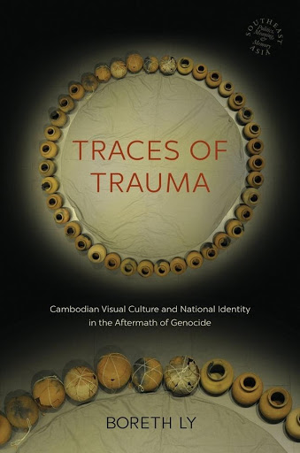 """The cover of Ly's book, a central off-white circle with the title """"Traces of Trauma"""" encircled by vessels on a black background."""